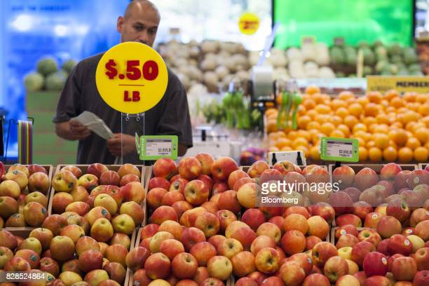 A customer browses produce displayed for sale during the grand opening of a Whole Foods Market 365 location in Santa Monica California US on...