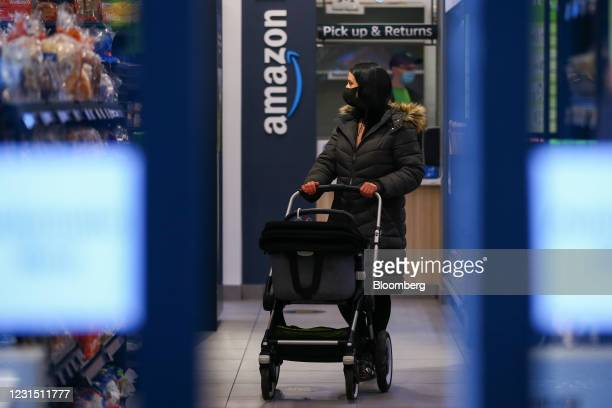 Customer browses products at the Amazon.com Inc. Amazon Fresh cashierless convenience store in the Ealing area of London, U.K., on Thursday, March 4,...