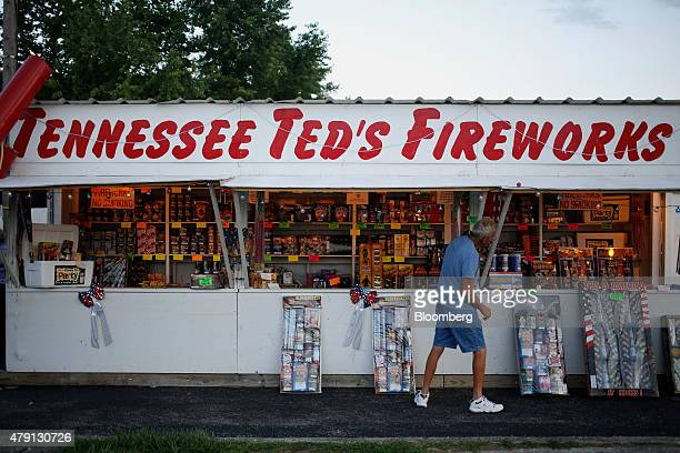 A customer browses products displayed for sale at Tennessee Ted's Fireworks stand in Shelbyville Kentucky US on Sunday June 28 2015 As the 4th of...