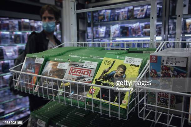 Customer browses products near a Xbox games console copy of Cyberpunk 2077, produced by CD Projekt SA, in a video games store in Paris, France, on...