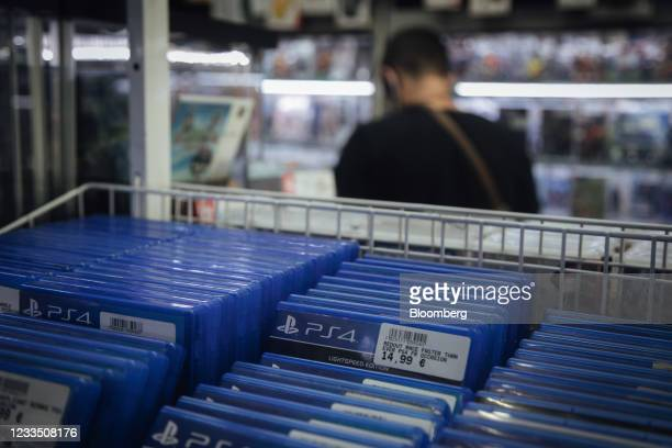 Customer browses products near copies of PlayStation 4 games at a video games store in Paris, France, on Thursday, June 17, 2021. The reinstatement...