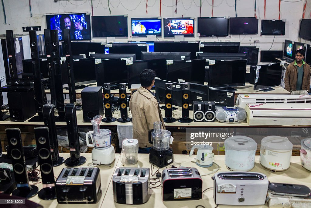A customer browses refurbished goods on display in the retail outlet at the refurbishment facility of GreenDust, a unit of Reverse Logistics Co., in New Delhi, India, on Friday, Jan. 16, 2015. Reverse Logistics, an Indian retailer of refurbished goods, is a factory outlet store in India selling goods through its GreenDust brand franchise stores and website. Photographer: Prashanth Vishwanathan/Bloomberg via Getty Images