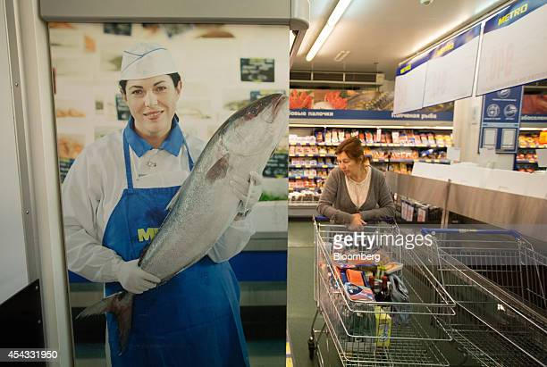 A customer browses seafood products inside a Metro Cash Carry store the Russia unit of Metro AG in Moscow Russia on Friday Aug 29 2014 Metro Cash...