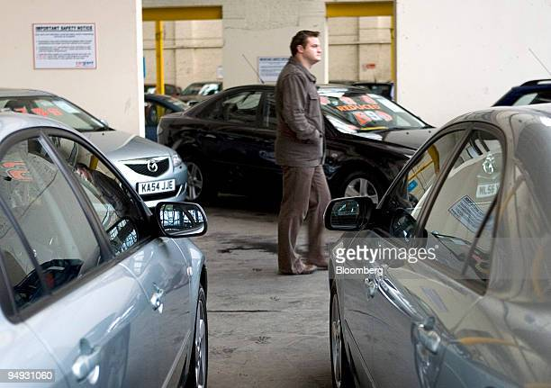 A customer browses secondhand vehicles for sale at a car dealership in London UK on Tuesday Nov 4 2008 British care sales are likely to show their...