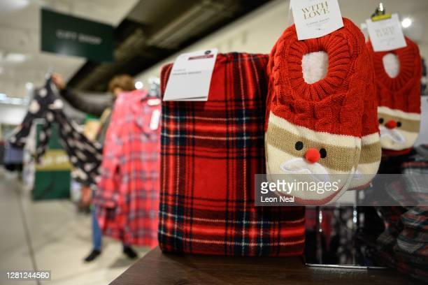 Customer browses some of the festive items in the Christmas gift and decoration section in the branch of retailer Marks and Spencer at Westfield...