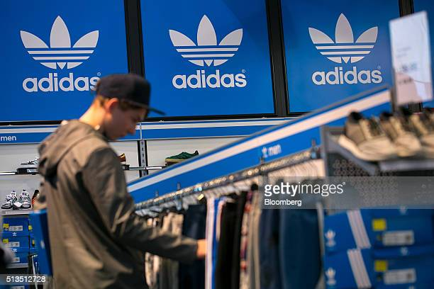 c4f5c367cd A customer browses sports apparel inside the Adidas AG store at the company s  headquarters in Herzogenaurach