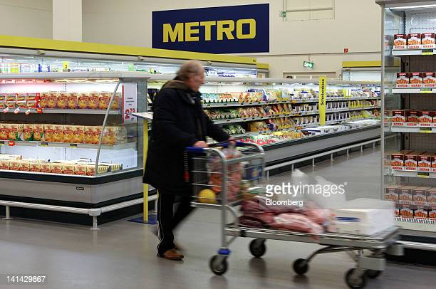 A customer browses the aisles of a Metro AG Cash Carry store in Weiterstadt Germany on Friday March 16 2012 Metro AG Germany's largest retailer said...
