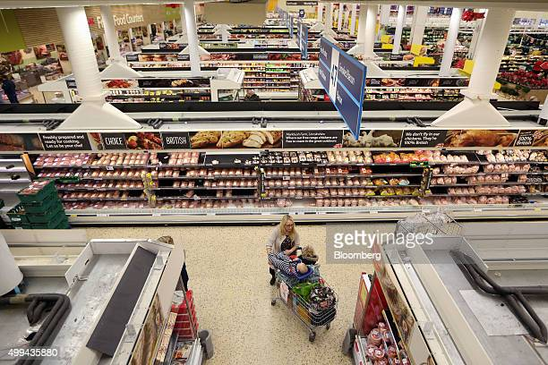 A customer browses the chilled products section at the Tesco Basildon Pitsea Extra supermarket operated by Tesco Plc in Basildon UK on Tuesday Dec 1...