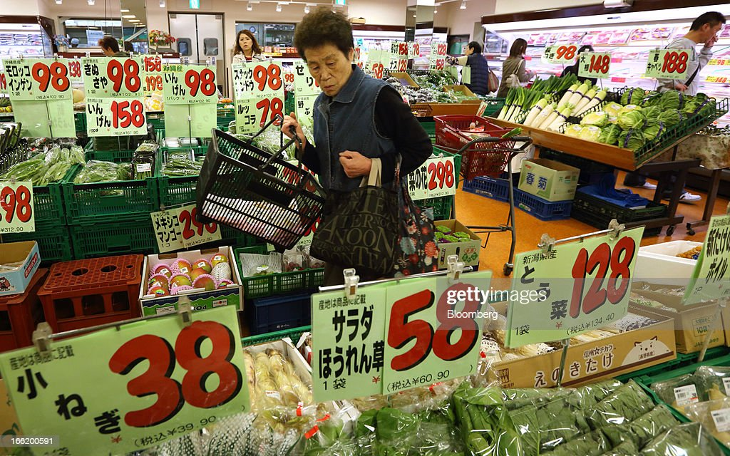 A customer browses vegetables at a supermarket in Tokyo, Japan, on Tuesday, April 9, 2013. After Bank of Japan Governor Haruhiko Kuroda's first policy meeting as governor on April 4, the central bank set a two-year horizon for the 2 percent annual price-increase target that it adopted in January at the urging of Prime Minister Shinzo Abe. Photographer: Tomohiro Ohsumi/Bloomberg via Getty Images