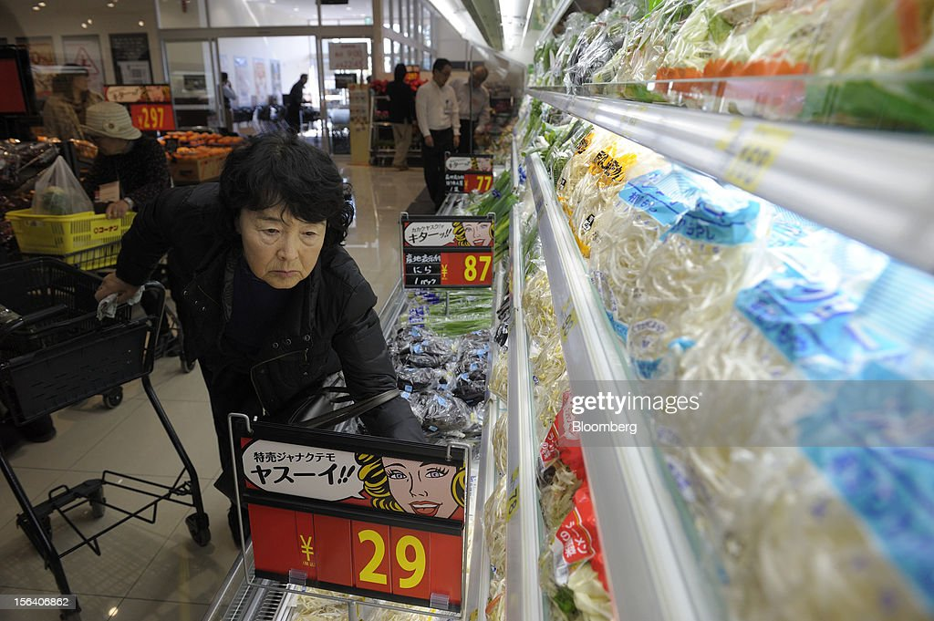 A customer browses vegetables in a Seiyu GK supermarket in Tokyo, Japan, on Wednesday, Nov. 14, 2012. Seiyu GK is a unit of Wal-Mart Stores Inc. Photographer: Akio Kon/Bloomberg via Getty Images
