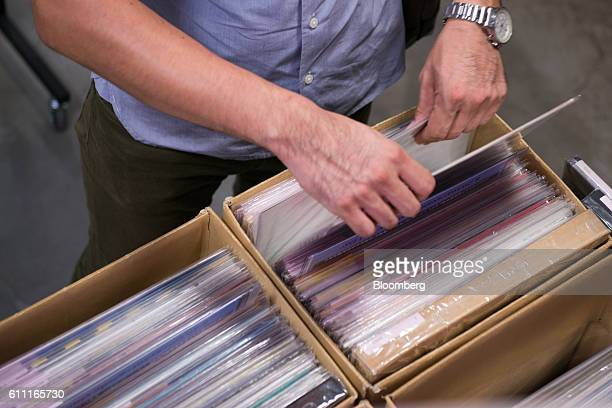 A customer browses vinyl records at the HMV Record Shop operated by Lawson HMV Entertainment Inc in the Shibuya district of Tokyo Japan on Wednesday...