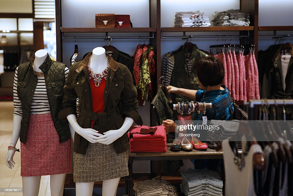 A Customer Browses Womens Clothing For Sale At A Banana Republic