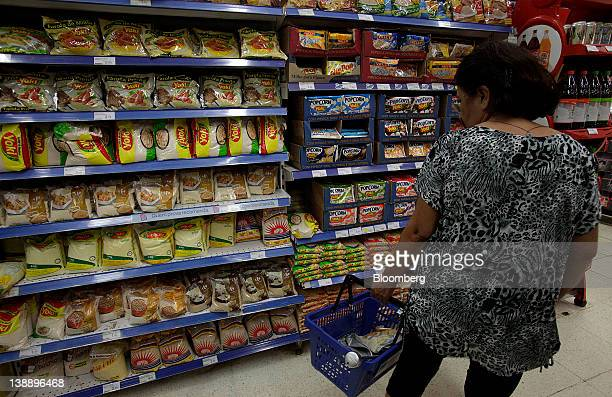 A customer browses Yoki Alimentos SA products displayed for sale at a supermarket in Brasilia Brazil on Monday Feb 13 2012 General Mills Inc agreed...