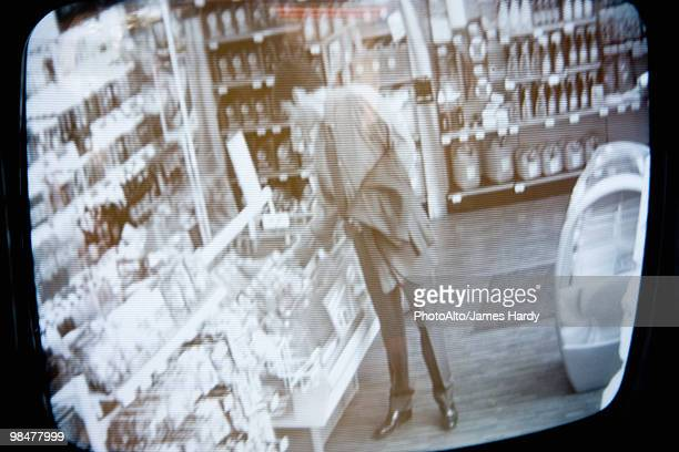 customer browsing in convenience store, image captured by surveillance camera - business security camera stock pictures, royalty-free photos & images