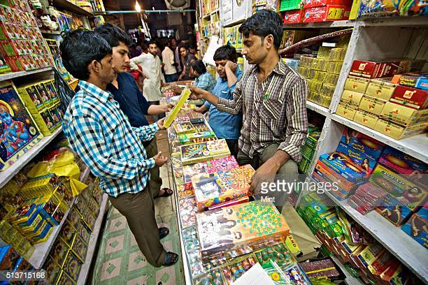 Customer buying firecrackers having film stars pictures on covers during Dhanteras on October 30 2013 in New Delhi India