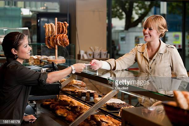 Customer buying fresh bread
