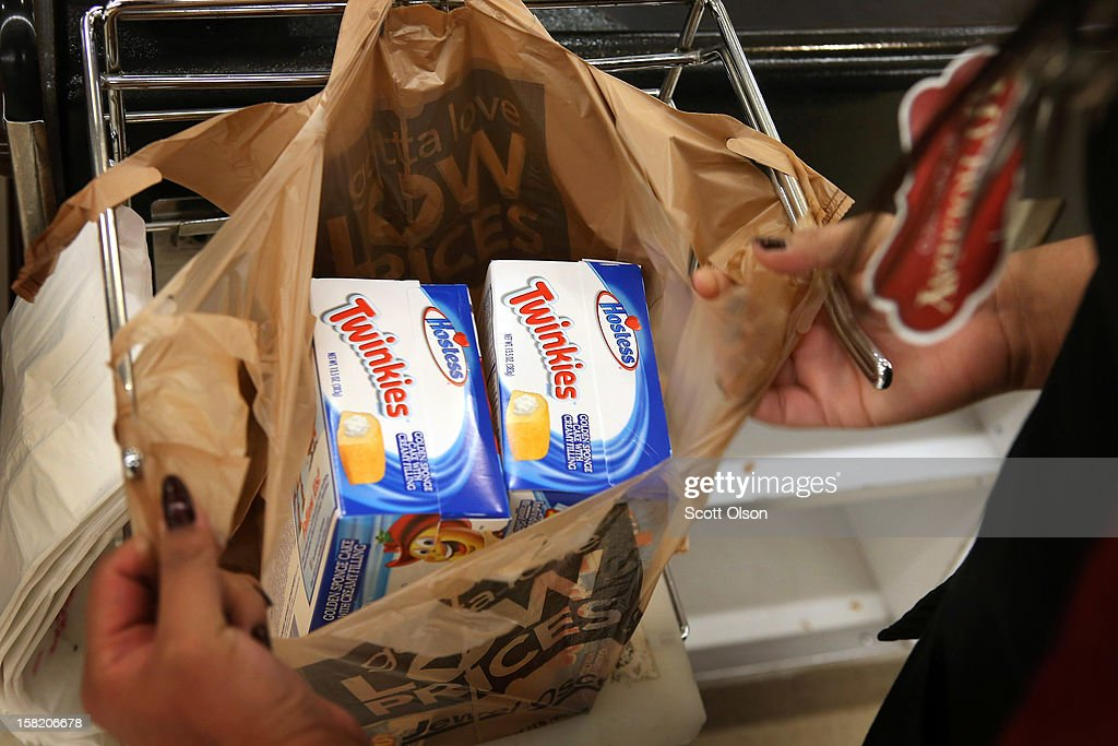 A customer buys boxes of Hostess snacks at a Jewel-Osco grocery store on December 11, 2012 in Chicago, Illinois. The Jewel-Osco grocery store chain purchased the last shipment of 20,000 boxes of Hostess products and put them on sale in their stores throughout the Chicago area today. Hostess Brands Inc. shut down its baking operations and began liquidating assets last month after failing to negotiate a labor contract with Workers with the Bakery, Confectionery, Tobacco Workers and Grain Millers International Union
