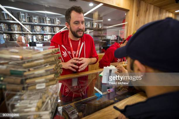 A customer buys cannabis products at MedMen one of the two Los Angeles area pot shops that began selling marijuana for recreational use under the new...