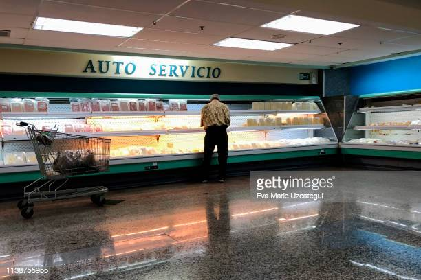 A customer buys cheese and dairy products at one of the stores of the company Automercados Plaza's with few products available for sale on April 4...