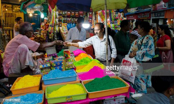 A customer buys Holi celebration items from a market in Kolkata India on 19 March 2019 The Hindu Festival of Holi also known as Festival of colours...