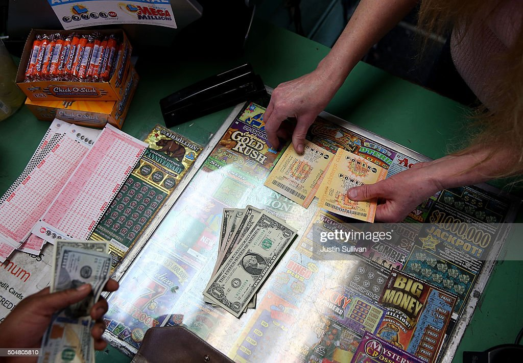 A customer buys Powerball tickets at Kavanagh Liquors on January 13, 2016 in San Lorenzo, California. Dozens of people lined up outside of Kavanagh Liquors, a store that has had several multi-million dollar winners, to -purchase Powerball tickets in hopes of winning the estimated record-breaking $1.5 billion dollar jackpot.