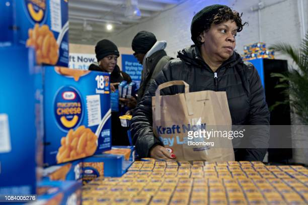 A customer carries a bag of free Kraft Heinz Co products at a store opened for federal workers during a partial government shutdown in Washington DC...