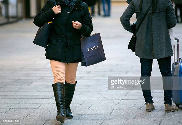 9b620ae3 A customer carries a branded shopping bag from the Zara fashion store  operated by Inditex SA