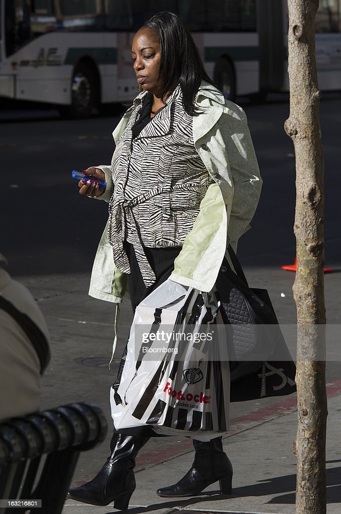 A customer carries a Foot Locker Inc. shopping bag in Oakland, California, U.S., on Tuesday, March 5, 2013. Foot Locker Inc. is expected to release earnings data on March 8. Photographer: David Paul Morris/Bloomberg via Getty Images