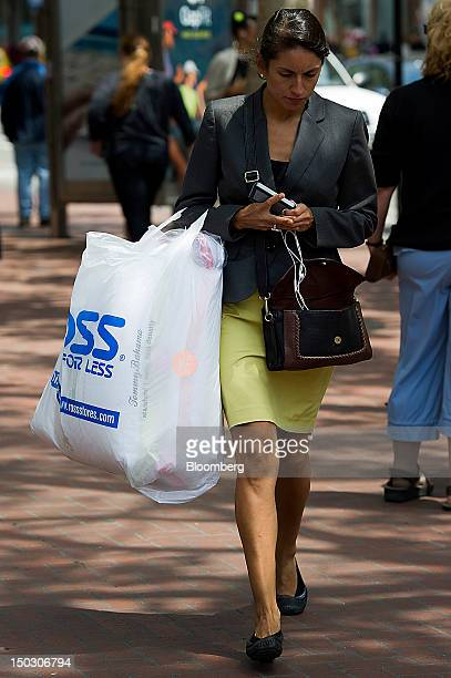 Customer carries a Ross Stores Inc. Shopping bag in San Francisco, California, U.S., on Tuesday, Aug. 14, 2012. Ross Stores Inc. Is expected to...