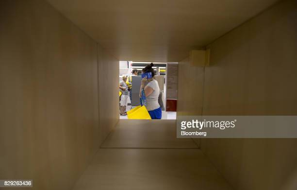 A customer carries a yellow IKEA bag while shopping on the opening day of IKEA of Sweden AB's first department store in Belgrade Serbia on Thursday...