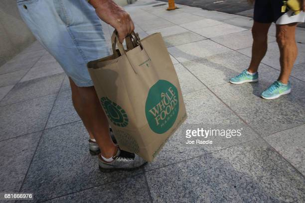 A customer carries his Whole Foods Market bag as the company appointed five new directors to its board and replaced its chairman on May 10 2017 in...