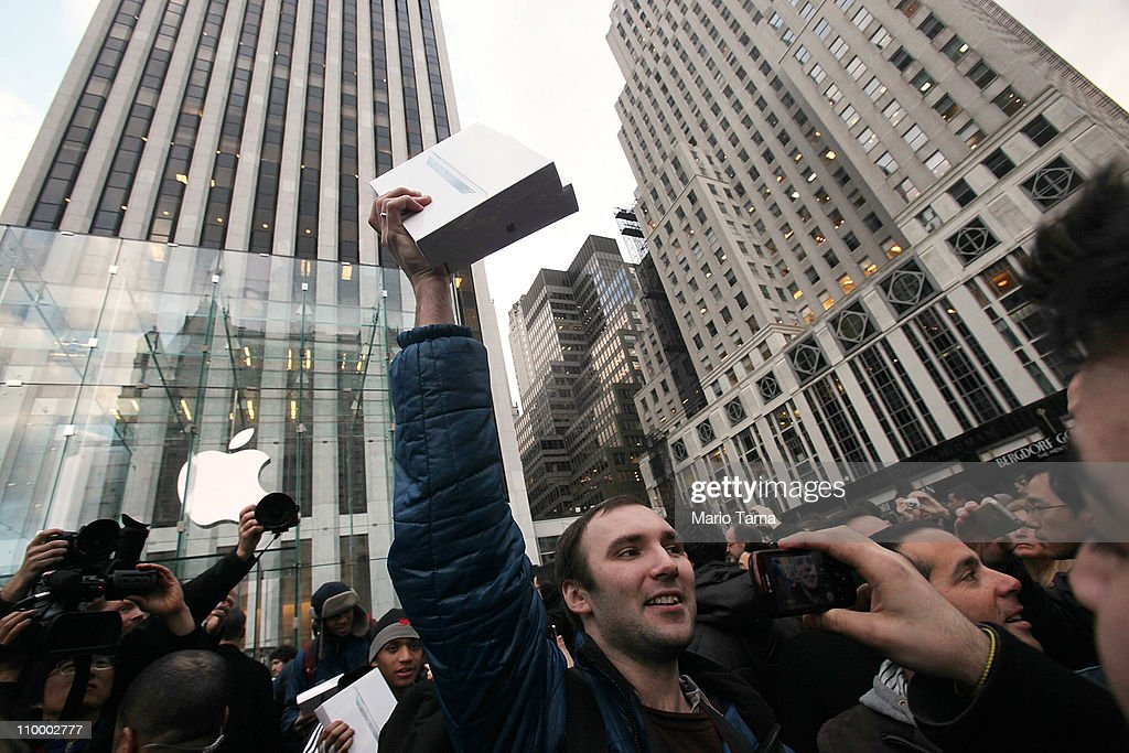 A customer carries two new iPad 2's he purchased minutes after they went on sale at the Fifth Avenue Apple store March 11, 2011 in New York City. The iPad 2 became available at 4:00 a.m. Eastern time for online purchase and at 5:00 p.m. today in over 10,000 retail locations.