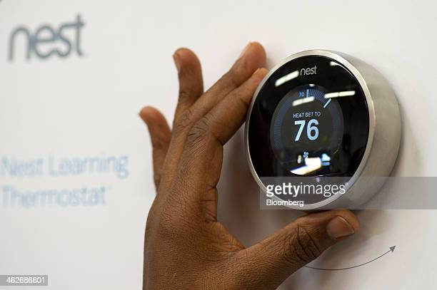 A customer checks a Nest Labs Inc digital thermostat on display at a Home Depot Inc store in Emeryville California US on Tuesday Jan 14 2014 Google...