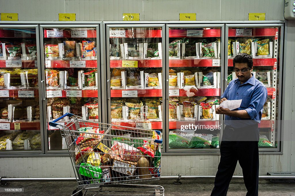 A customer checks his shopping list in front of the frozen foods section of a Bharti Walmart Pvt Ltd Best Price Modern Wholesale store in Zirakpur on.