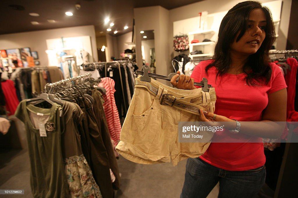 A customer checks out shorts at the Pramod store at Select Citywalk in New Delhi on May 26, 2010.