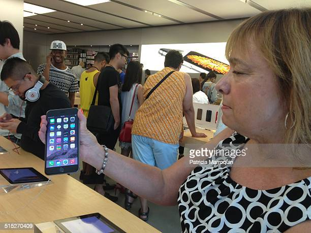 A customer checks out the iPhone 6 Plus at the Apple Store at Westfield Topanga shopping center in Canoga Park California on September 19 2014