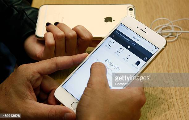 A customer checks the new iPhone 6s displayed at the Apple Store Opera on September 25 2015 in Paris France Apple launched the new iPhone 6s and...