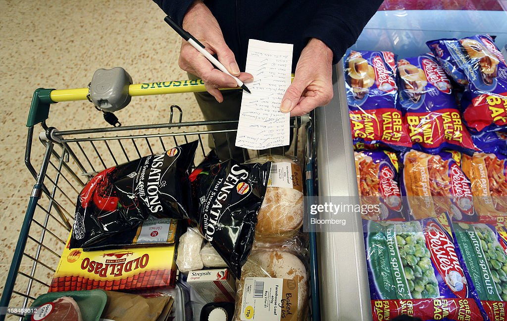 A customer checks their shopping list inside a Morrisons supermarket, operated by William Morrisons Supermarkets Plc, in Chadderton, U.K., on Monday, Dec. 17, 2012. The British Christmas is the biggest epicurean occasion of the year, with households spending a total of 4 billion pounds on food in the final week before Dec. 25. Photographer: Paul Thomas/Bloomberg via Getty Images