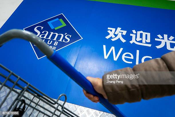 A customer chooses a shopping cart at the entrance of a Sam's club store Sams Club plans a strong growth in China in coming years selling higherend...