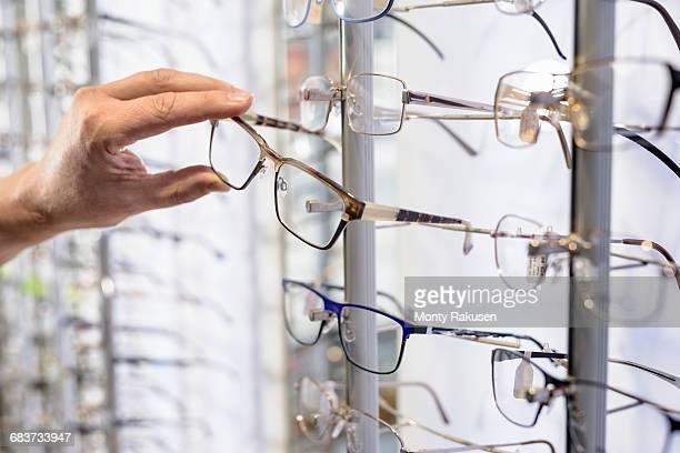 Customer choosing frames at small business opticians, close up