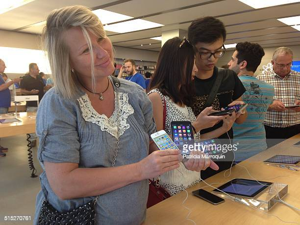 A customer compares sizes of iPhones at the Apple Store at Westfield Topanga shopping center in Canoga Park California on September 19 2014