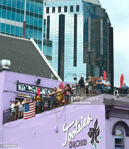 Customer crowd the rooftop bar at Tootsie's Orchid Lounge an iconic bar and live country music venue in the Lower Broadway entertainment district in...