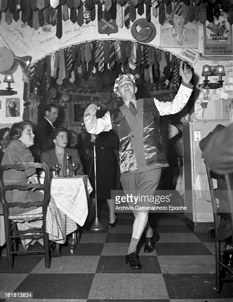 A customer dances in front of Lady Patachou while she is singing Paris 1950s