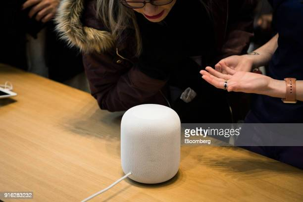 A customer demonstrates the HomePod speaker on the first day of sales at an Apple Inc store in New York US on Friday Feb 9 2018 Apple Inc's...