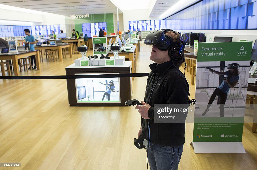 A customer demonstrates the HTC Vive virtual reality (VR) system at a Microsoft Corp. store in Bellevue, Washington, U.S., on Thursday, Jan. 26, 2017. Microsoft Corp.'s second-quarter sales and profit exceeded analysts' projections, bolstered by rising customer sign-ups for Azure and Office cloud-computing services. Photographer: David Ryder/Bloomberg via Getty Images