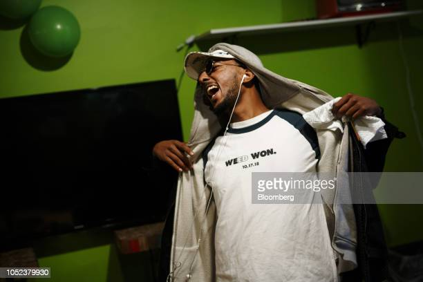 A customer displays a shirt reading 'Weed Won' on cannabis legalization day at the Hotbox Lounge and Shop in Toronto Ontario Canada on Wednesday Oct...