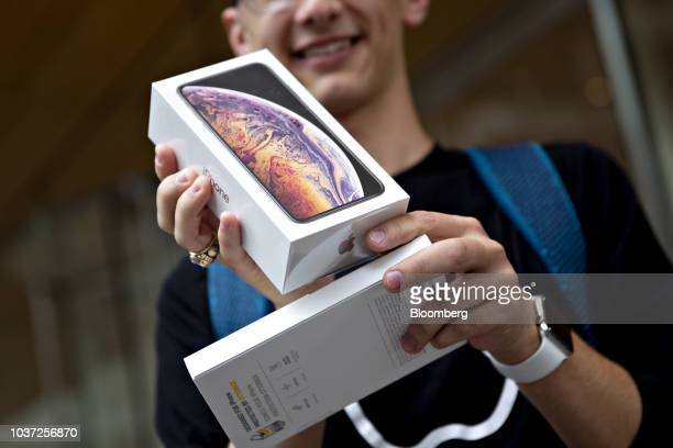 A customer displays an Apple Inc iPhone XS Max box during a sales launch at a store in Chicago Illinois US on Friday Sept 21 2018 The iPhone XS is up...