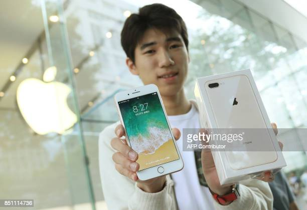 A customer displays his new iPhone 8 plus smartphone on its launching day in Tokyo on September 22 2017 Apple's iPhone 8 iPhone 8 plus and Apple...