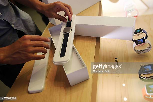 A customer displays his new model Apple watch with a new rubber band in an Apple store on September 10 2015 in New York City The Cupertino California...