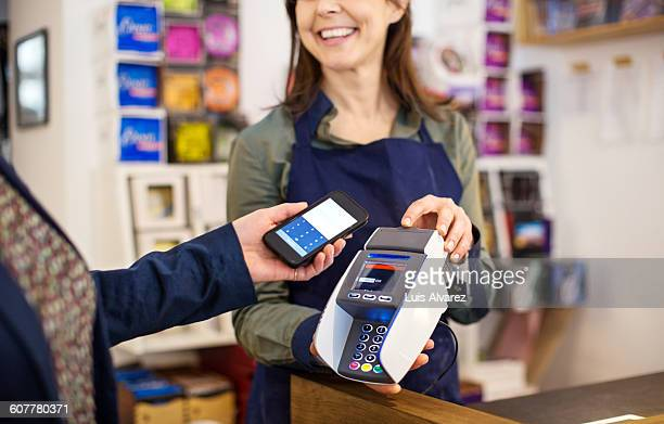 Customer doing NFC payment by worker